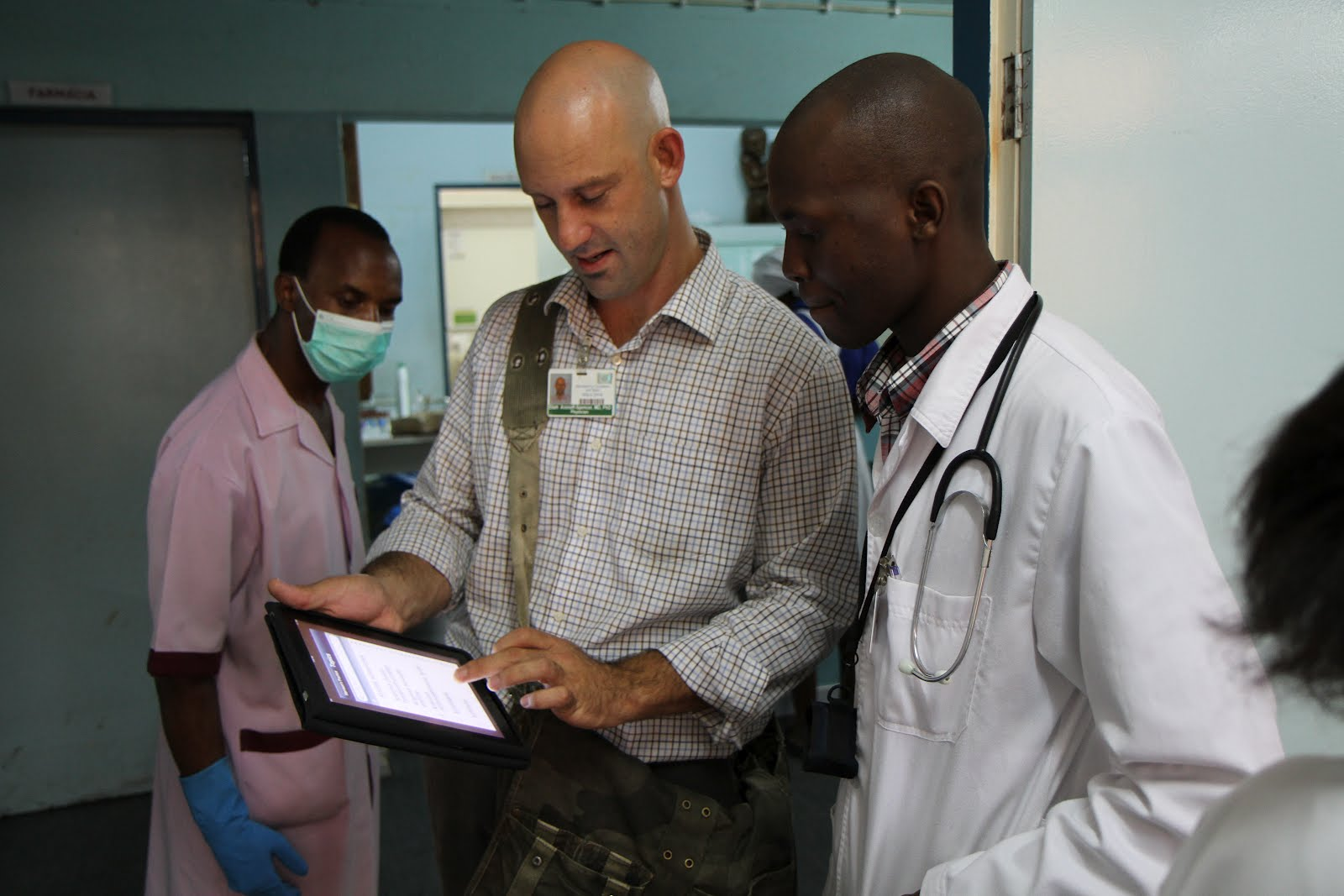 Dr. Eliah Aronoff-Spencer discusses new DH Lab-developed technologies with a doctor at Mozambique's Universidade Eduardo Mondlane