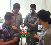Students from Printable Robotics Class holding drone