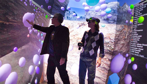 Thomas Levy with student in the QI StarCAVE