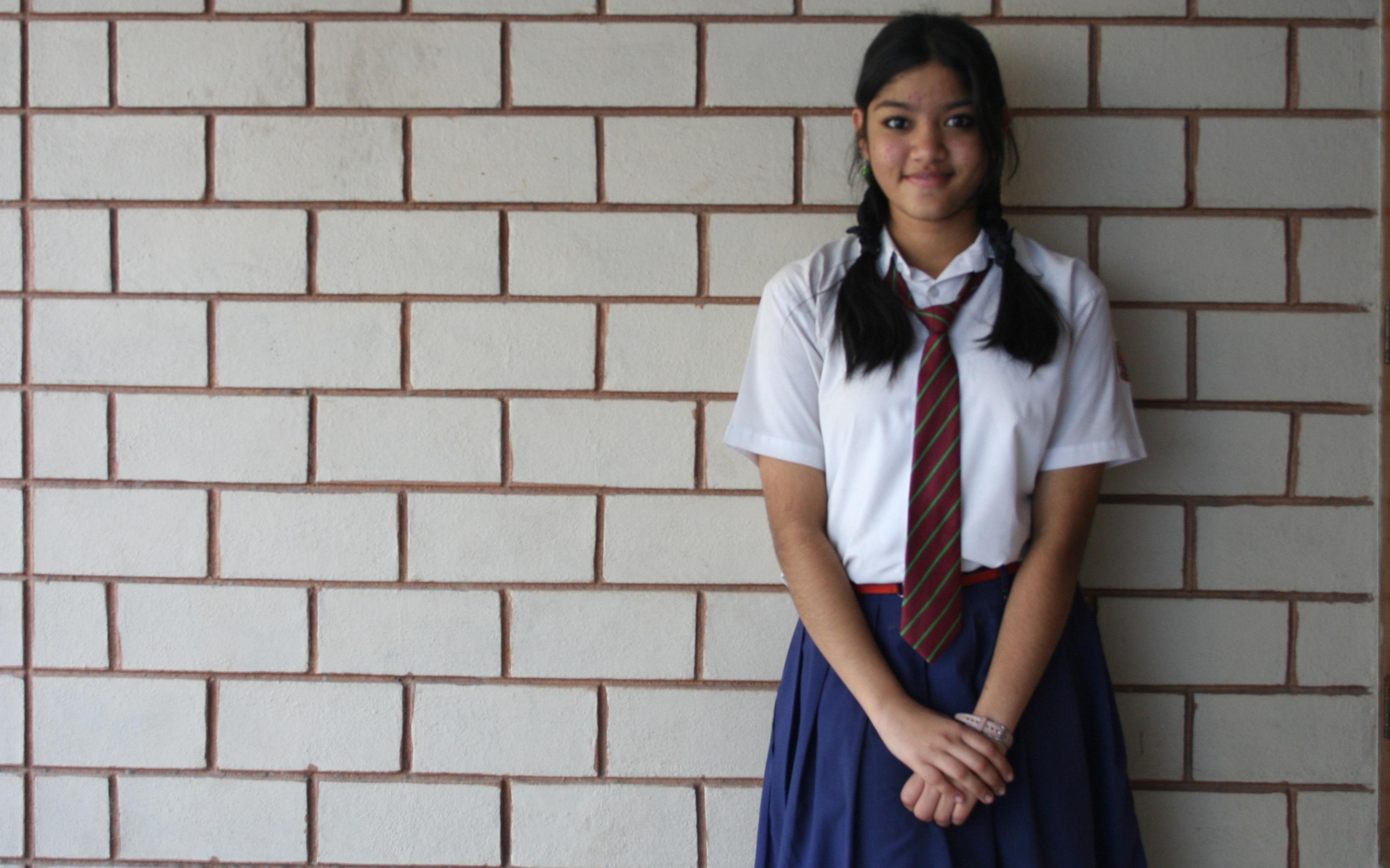 Schoolgirl standing and smiling