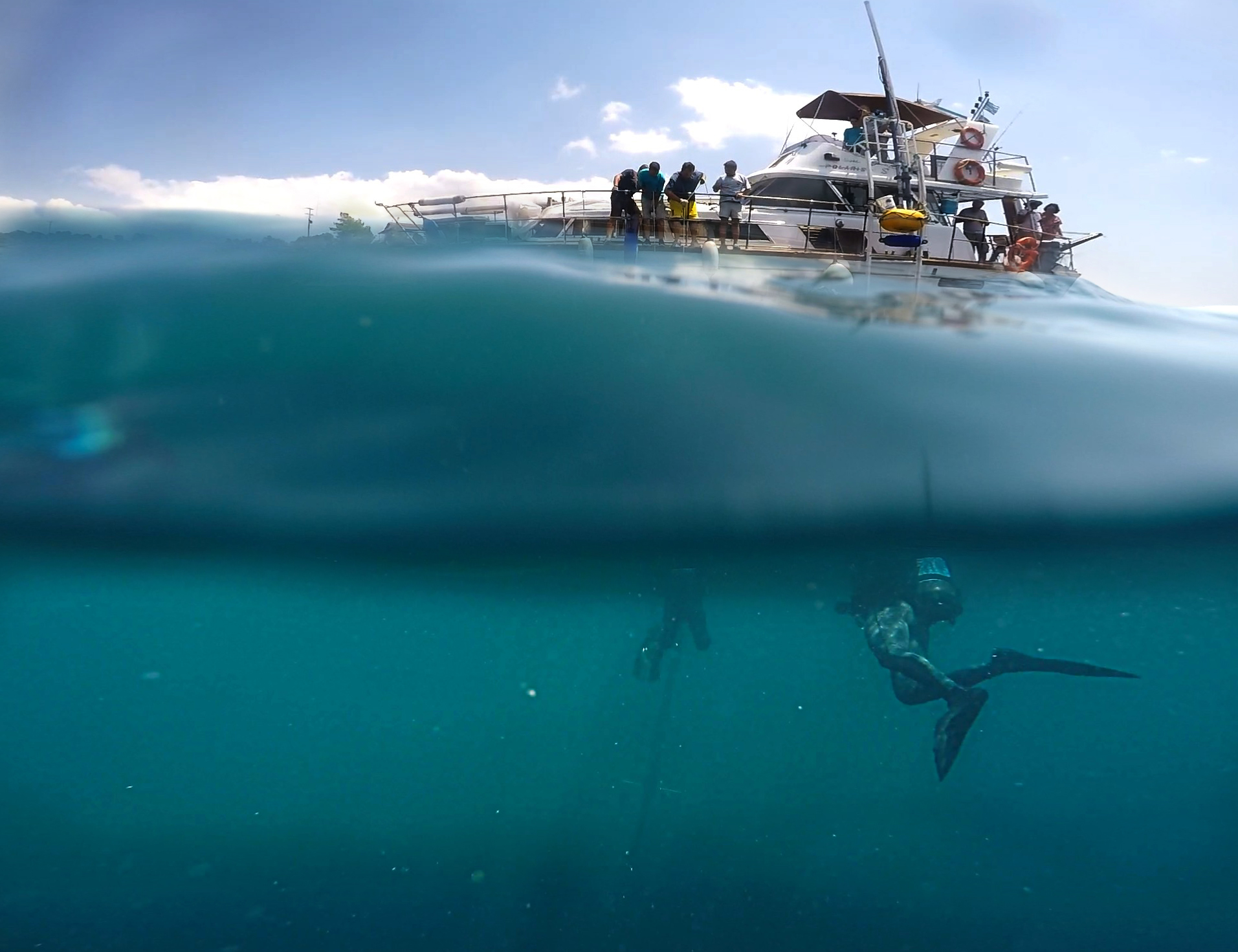 Divers below the research yacht