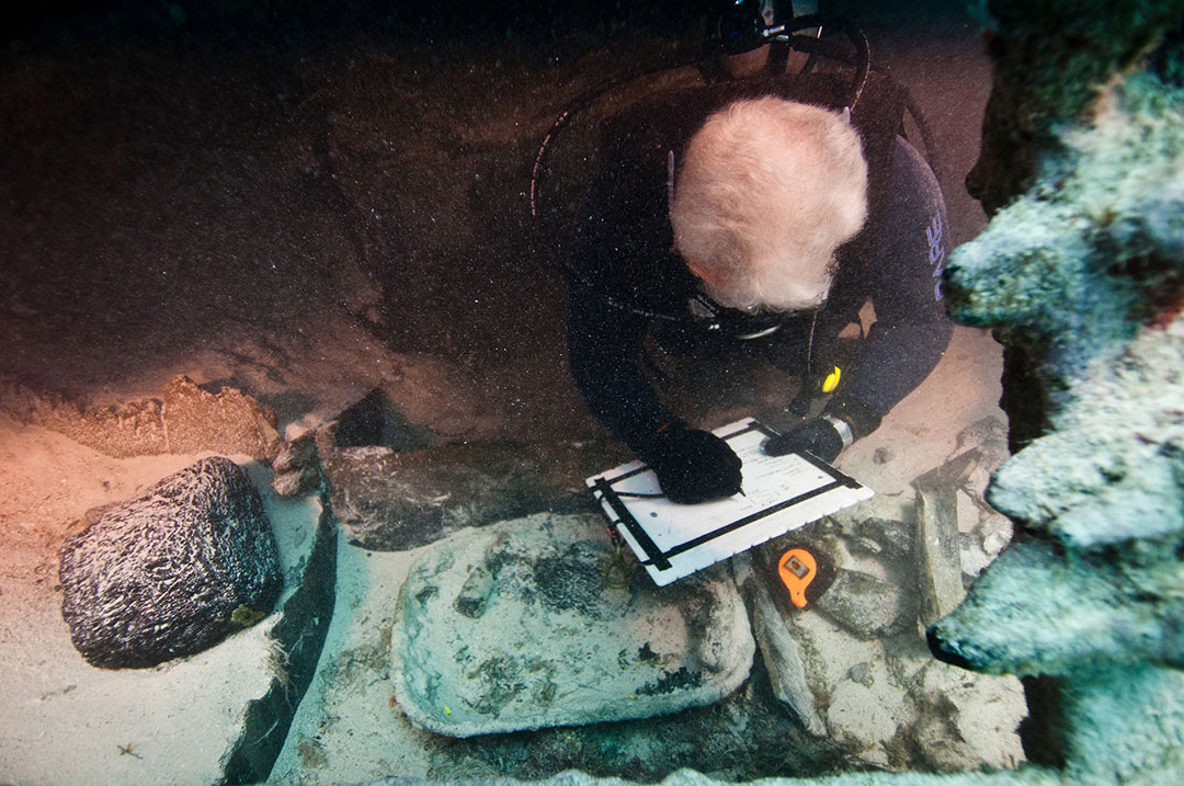 A diver examines the wreck of the Mary Celestia
