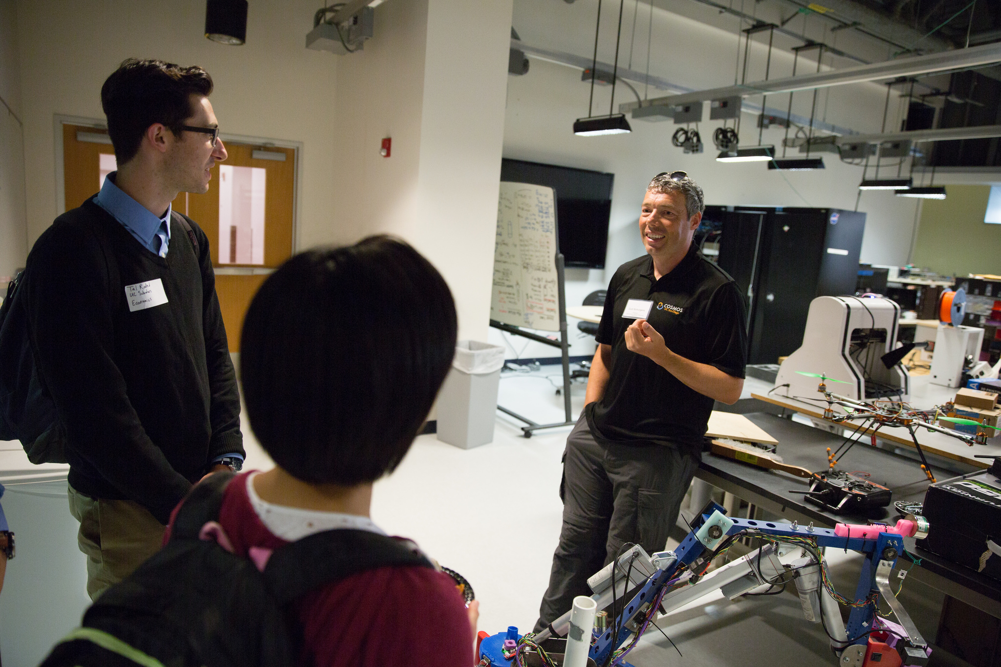Curt Schurgers answers questions from students during a tour of the QI Prototyping Lab