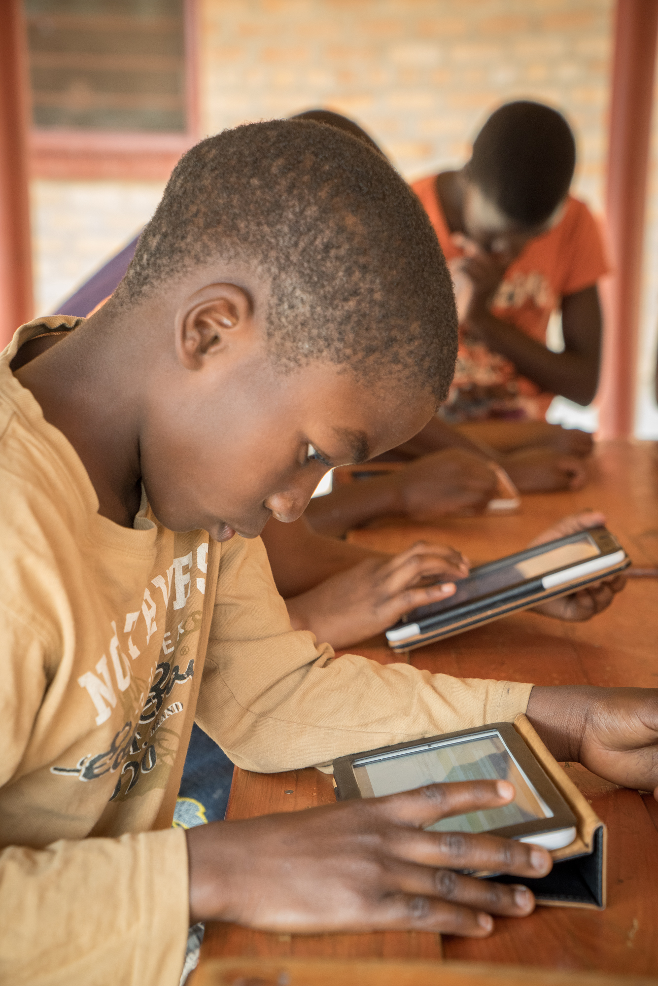 Prosper, 11years old, interacting with KA Lite on a tablet, in Zambia.