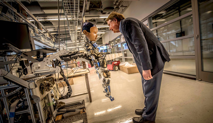 Larry Smarr with Diego-San, one of the robots in the Contextual Robotics Lab at Calit2/Qualcomm Institute