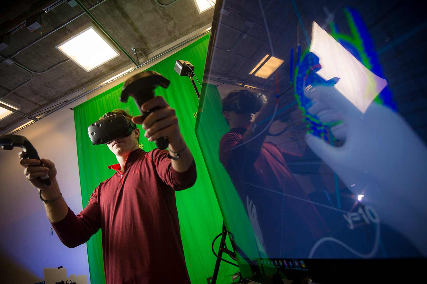 Steven McCloskey, co-founder of a new virtual reality startup, manipulates objects in an immersive environment.