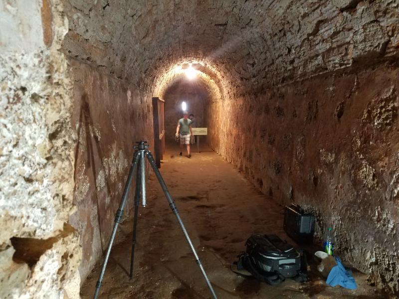 A student investigates the interior of El Abanico Fort