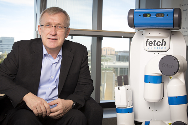 Contextual Robotics Institute Director Henrik Christensen with industry robot