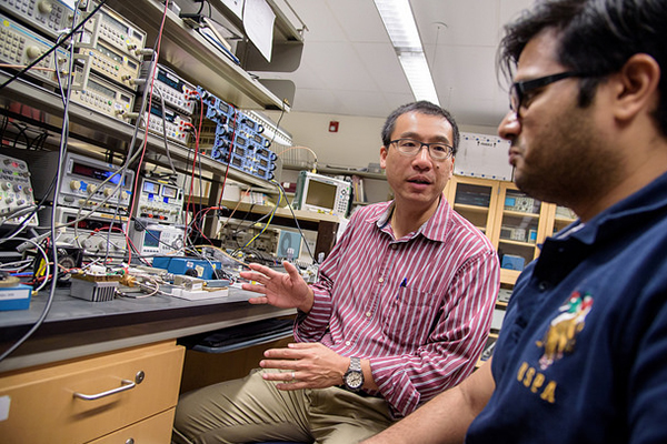 QI Circuits Lab manager Vincent Leung (center) will support UC San Diego and Brown researchers on th