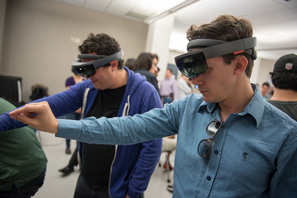 Using head-mounted display during open house for newly-finished Virtual Reality Lab in CSE.