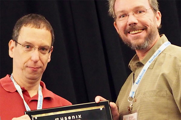 QI academic participant Geoffrey Voelker (right) accepts USENIX Security Test of Time Award for grou