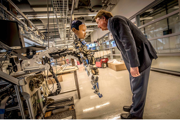 Larry Smarr with Diego-San, one of the robots in the Robot Zoo at Calit2