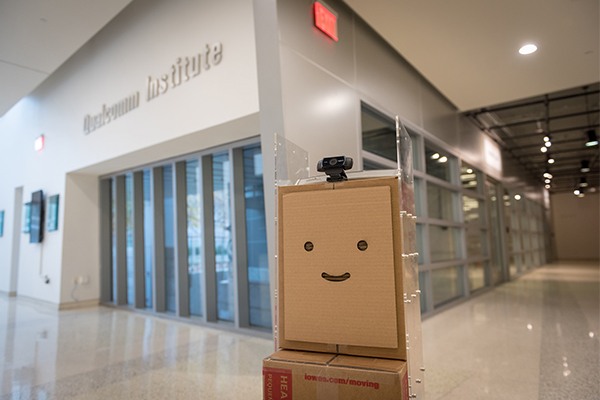 BoxBot stands in the lobby of the Qualcomm Institute